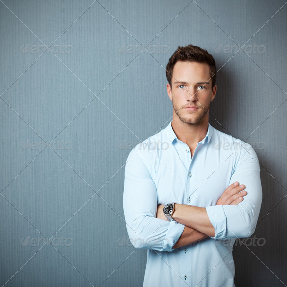 Portrait Of Serious Man Against Blue Background - Stock Photo - Images