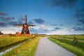 charming windmill in morning sunshine