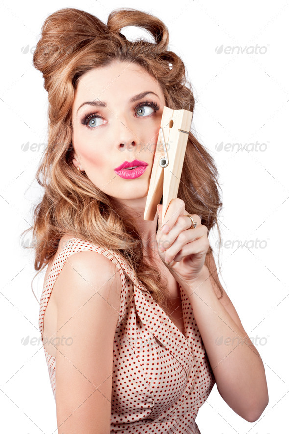 Pretty pinup housewife hanging out washing load - Stock Photo - Images