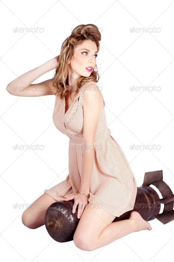 Female pinup bombshell on 50s military war missile - Stock Photo - Images