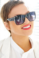 Glamour beautiful young woman with fashion sunglasses