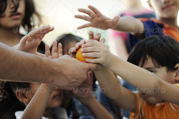 Hungry children in refugee camp, distribution of humanitarian food - Stock Photo - Images