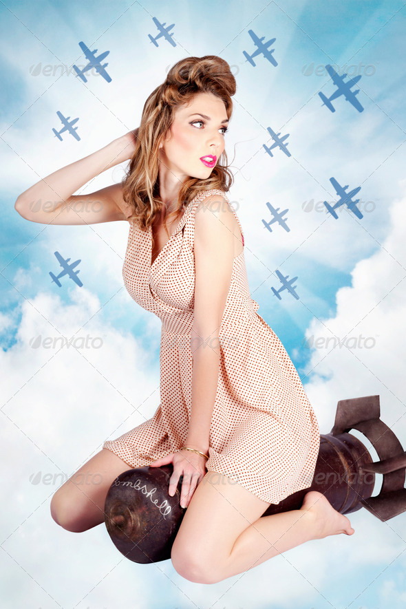 Classic pinup portrait. Female beauty on war bomb - Stock Photo - Images