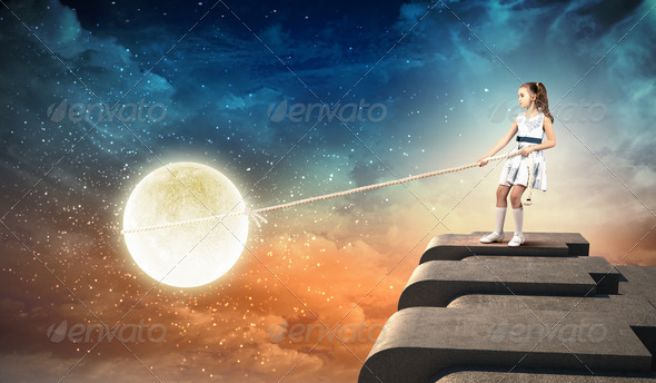Little girl pulling moon - Stock Photo - Images