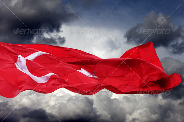 Waving flag of Turkey against storm clouds - Stock Photo - Images