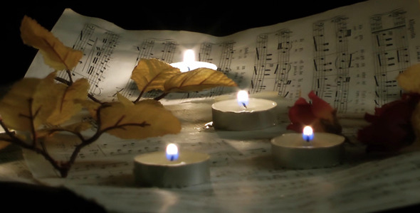 Candles Flowers And Music Sheets