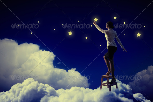 Woman lighting stars - Stock Photo - Images