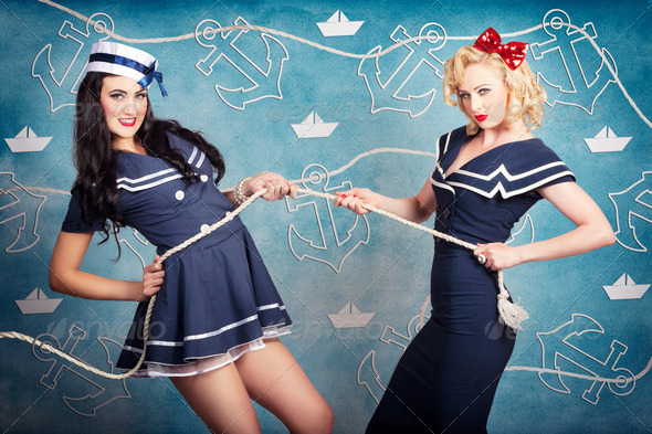 Beautiful navy pinup girls on marine background - Stock Photo - Images
