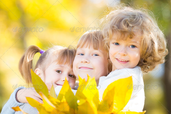 Children in autumn park - Stock Photo - Images