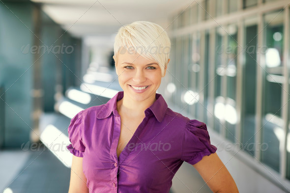 happy businesswoman looking and smiling at camera - Stock Photo - Images