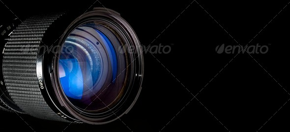 Photography lens over black - Stock Photo - Images