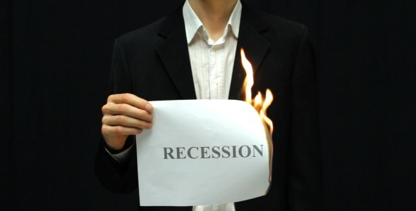 Businessman Burn Recession Sign
