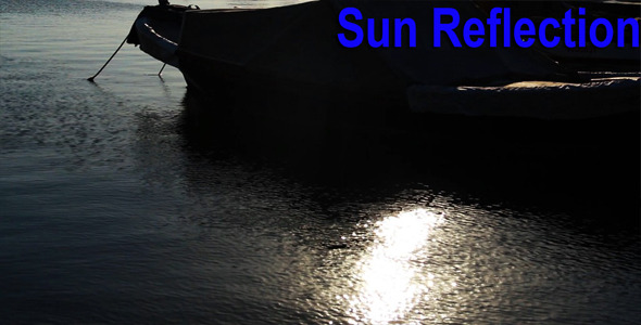 Boat And Sun Reflection
