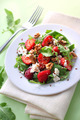 Salad with arugula, strawberries, goat cheese and walnuts