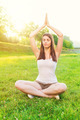 Cute young woman doing yoga outdoors - PhotoDune Item for Sale