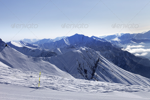 Ski slope and mountains in haze - Stock Photo - Images