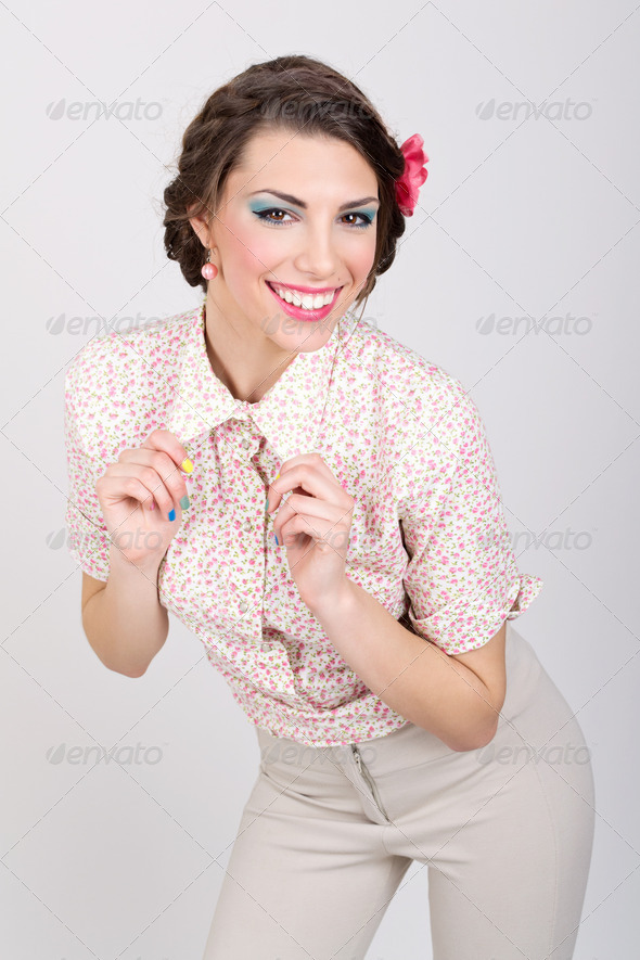 Cute retro woman wearing floral shirt - Stock Photo - Images