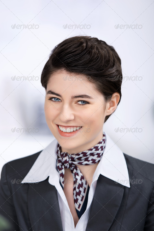 Smiling Young Businesswoman In Hotel - Stock Photo - Images