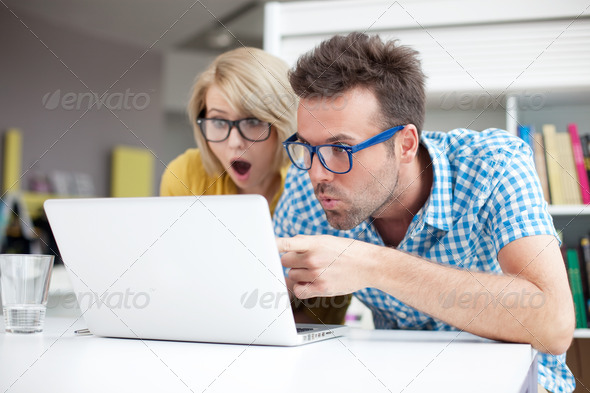 Two surprised students learning in library - Stock Photo - Images