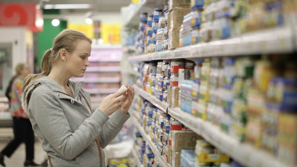 Young Woman is Choosing Food in the Supermarket 2