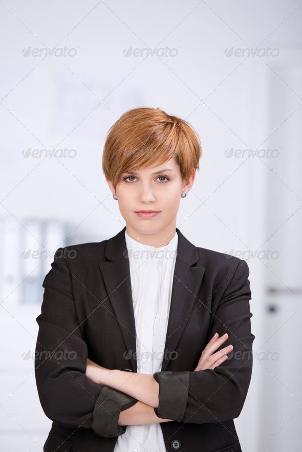 Businesswoman With Arms Crossed Standing In Office - Stock Photo - Images