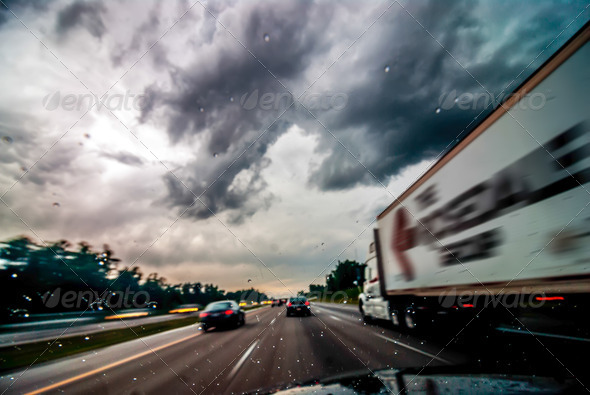 dramtatic sky and clouds with some rain while driving on a highw