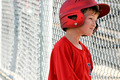 Little league baseball player in dugout - PhotoDune Item for Sale