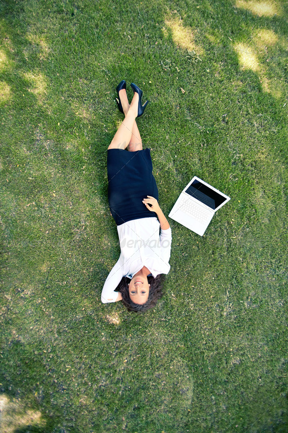 Businesswoman on grass - Stock Photo - Images