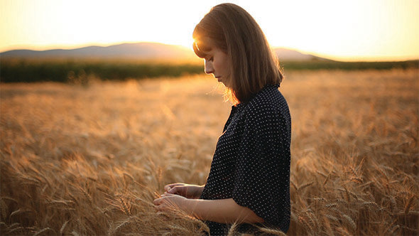 Girl On The Wheat Field