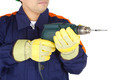 Hands of a worker holding a drill - PhotoDune Item for Sale