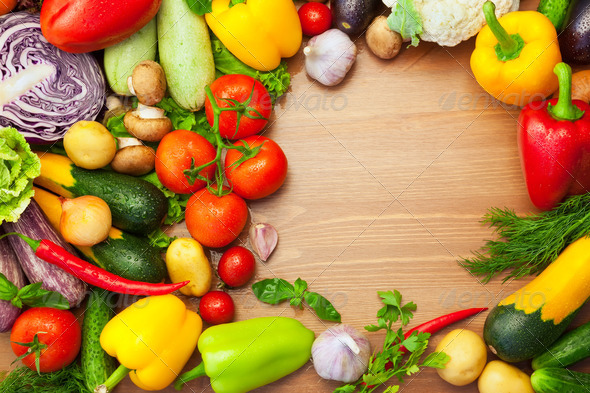 Fresh Organic Vegetables on wooden Table / Round