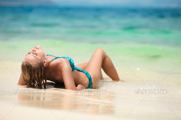 Young Woman Sunbathing At Tropical Beach - Stock Photo - Images