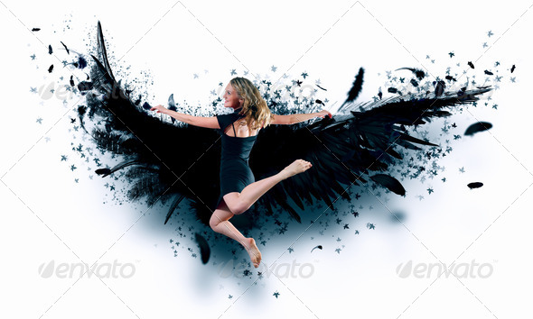 Woman floating   on dark wings - Stock Photo - Images