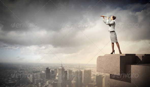 Business woman with telescope - Stock Photo - Images
