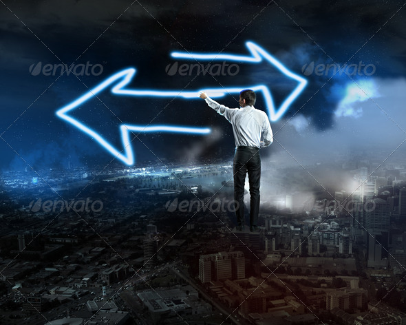 Businessman draws a glowing signs - Stock Photo - Images