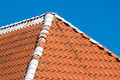Red roof tiles with sky