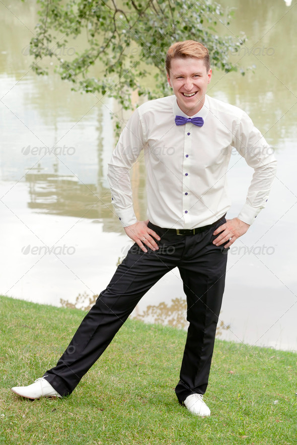 Young cheerful groom - Stock Photo - Images