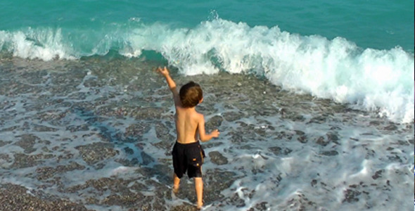 Boy Throwing Stones into the Sea