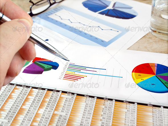 Analyzing Investment Charts. - Stock Photo - Images