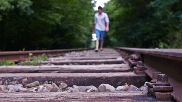 Man Walking on Railroad 4