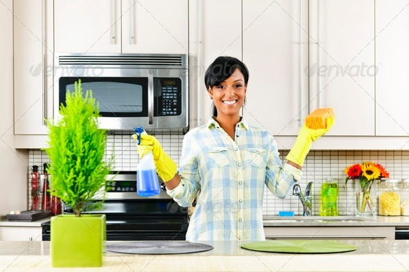 PhotoDune Young woman cleaning kitchen 538037
