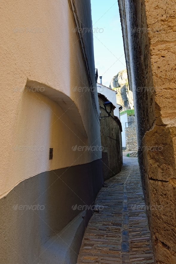 Narrow street in the small old town Ares in Spain. - Stock Photo - Images