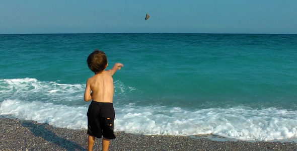 Boy Throwing Stones To The Sea 2