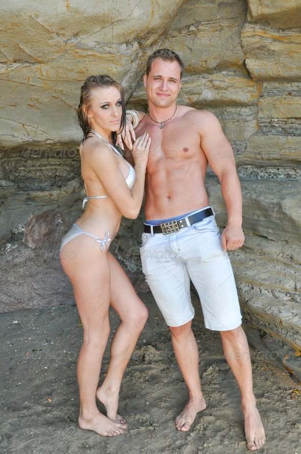 Fitness Couple at the Beach - Stock Photo - Images