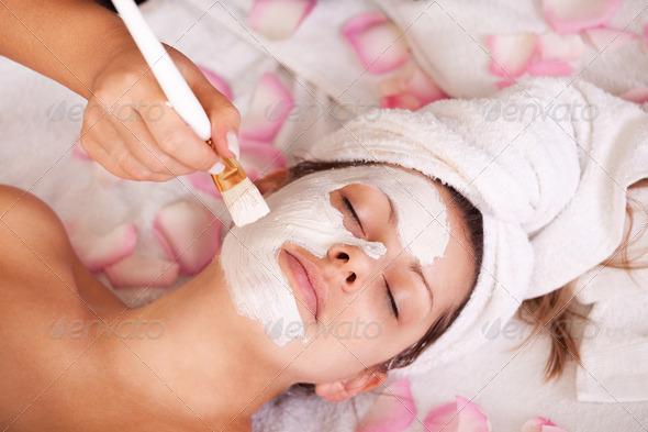 PhotoDune Young women getting facial mask 539452