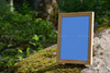 03_wood_photo_frame_in_nature_psd.__thumbnail