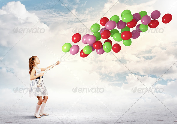 Little girl with balloons - Stock Photo - Images