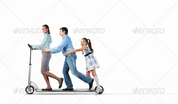 Happy family riding on scooter - Stock Photo - Images