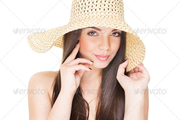Beautiful brunette wearing summer straw hat - Stock Photo - Images