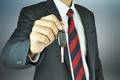 Businessman holding a car key - PhotoDune Item for Sale